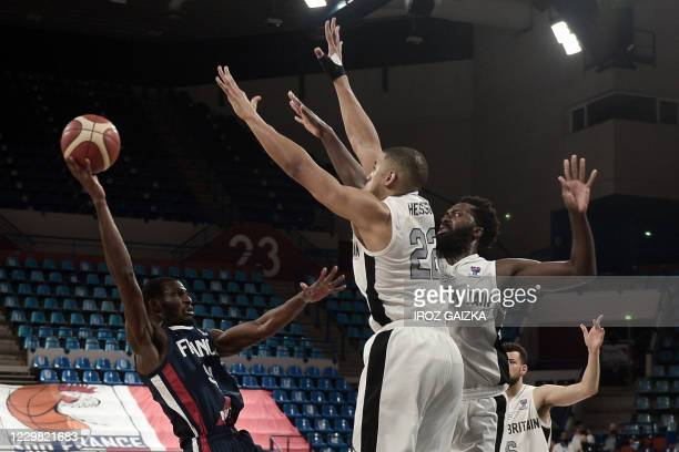 France's Lahaou Konate jumps to score during the Eurobasket 2020 basketball match France and England on November 27, 2020 in Pau southwestern France.