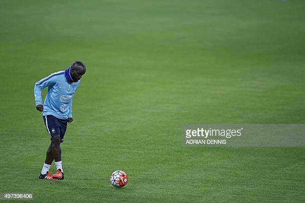 France's Lassana Diara attends a team training session at Wembley Stadium in west London on November 16 ahead of their international friendly...