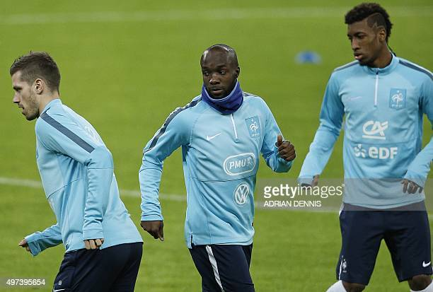 France's Lassana Diara warmsup with team mates during a training session at Wembley Stadium in west London on November 16 ahead of their...