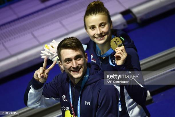 France's Laura Marino and France's Matthieu Rosset pose with their gold medal during the podium ceremony for the 3m/10m team event during the diving...