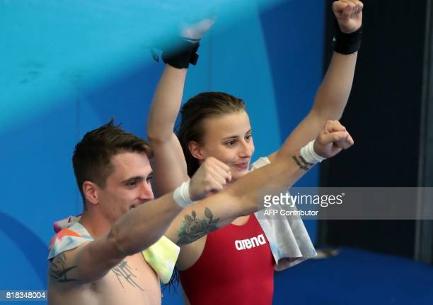France's Laura Marino and France's Matthieu Rosset react after winning the 3m/10m team event during the diving competition at the 2017 FINA World...