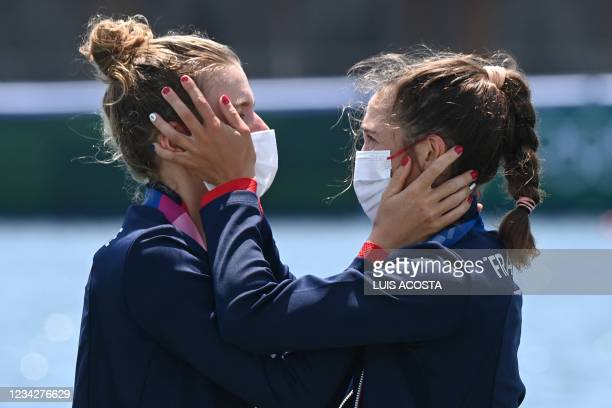 France's Laura Tarantola and Claire Bovein celebrate their silver performance in the lightweight women's double sculls final during the Tokyo 2020...