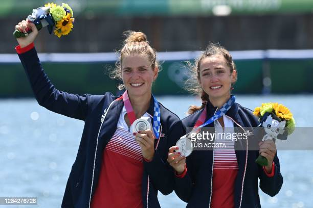 France's Laura Tarantola and Claire Bovein pose at the podium in the lightweight women's double sculls final during the Tokyo 2020 Olympic Games at...