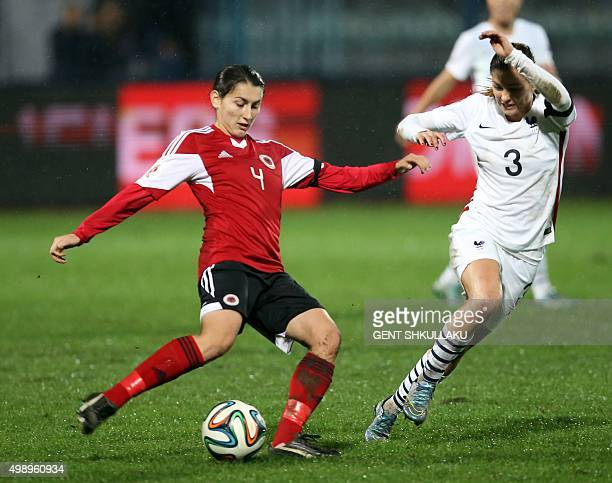 France's Laure Boulleau vies with Albania's Ezmiralda Franja during the womens Euro 2017 qualifying football match between Albania and France at the...