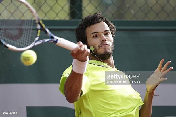 France's Laurent Lokoli returns the ball to USA's Steve Johnson during their French tennis Open first round match at the Roland Garros stadium in...