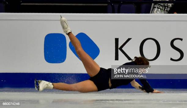 France's Laurine Lecavelier falls as she competes in the womens short program at the ISU World Figure Skating Championships in Helsinki Finland on...