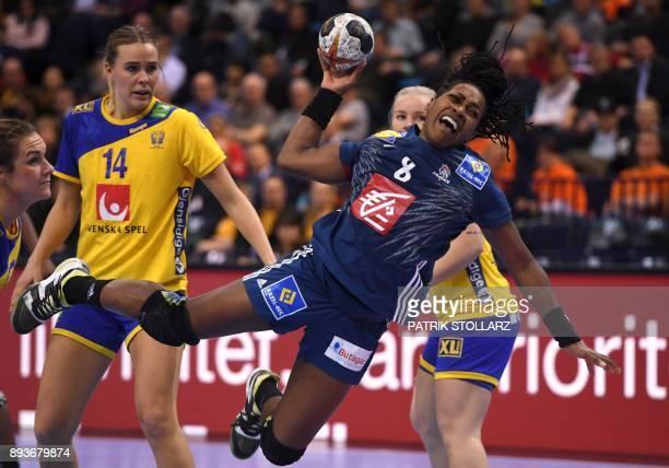 France´s Laurisa Landre shoots during the IHF Womens World Championship handball halffinal match Sweden vs France on December 15 2017 in Hamburg...