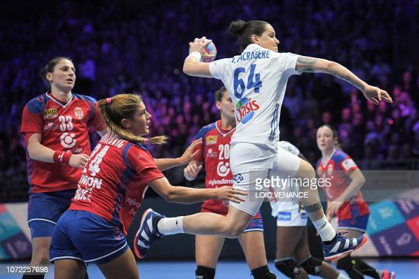 France's left back Alexandra Lacrabere jumps to shoot during the Women Euro 2018 handball Championships Group 1 main round match between Serbia and...