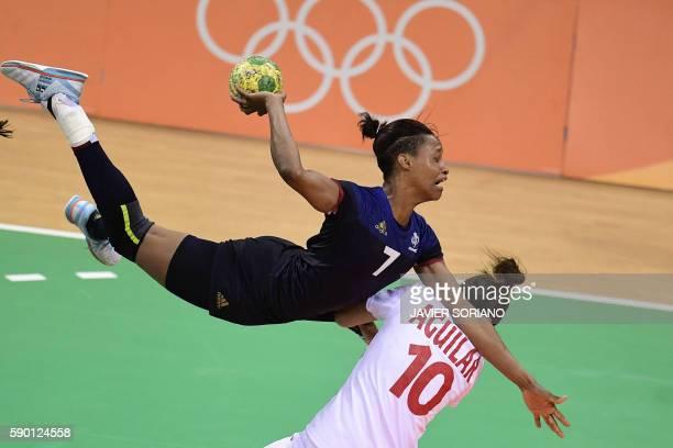 TOPSHOT France's left back Allison Pineau shoots past Spain's centre back Macarena Aguilar Diaz during the women's quarterfinal handball match Spain...