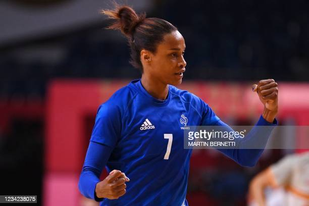 France's left wing Allison Pineau celebrates after scoring during the women's preliminary round group B handball match between France and Spain of...
