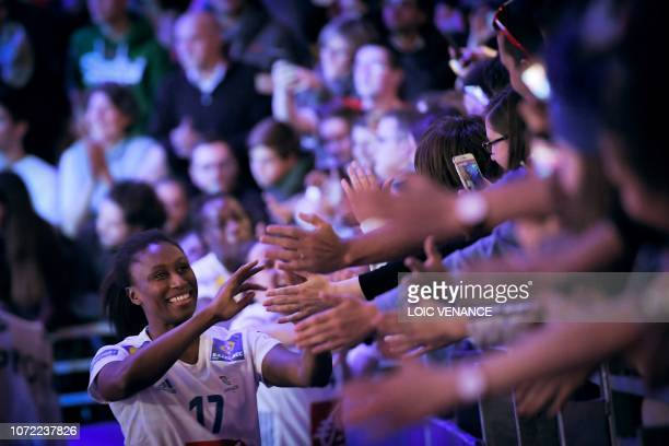 France's left wing and captain Siraba Dembele Pavlovic shakes hands with supporters after winning the Women Euro 2018 handball Championships Group 1...
