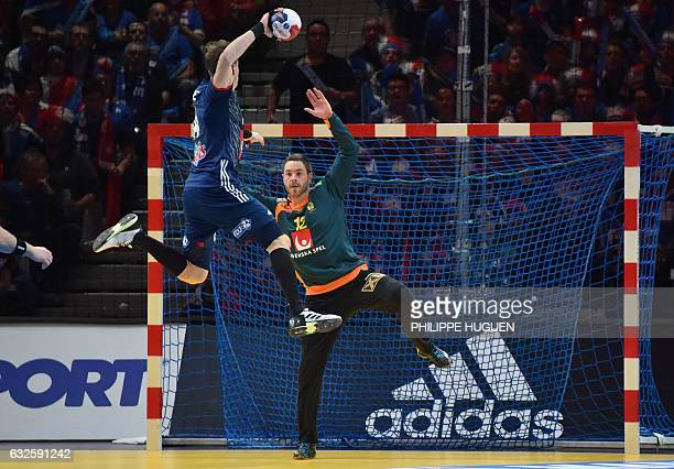 France's left wing Kentin Mahe jumps to shoot on goal as Sweden's goalkeeper Andreas Palicka stretches out during the 25th IHF Men's World...