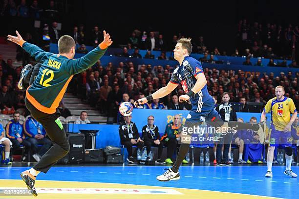 France's left wing Kentin Mahe shoots against Sweden's goalkeeper Andreas Palicka during the 25th IHF Men's World Championship 2017 quarter final...