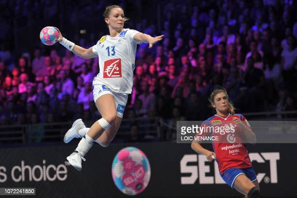 France's left wing Manon Houette jumps to shoot during the Women Euro 2018 handball Championships Group 1 main round match between Serbia and France,...