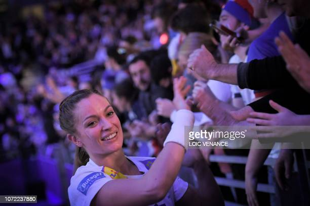 France's left wing Manon Houette shakes hands with supporters after winning after the Women Euro 2018 handball Championships Group 1 main round match...