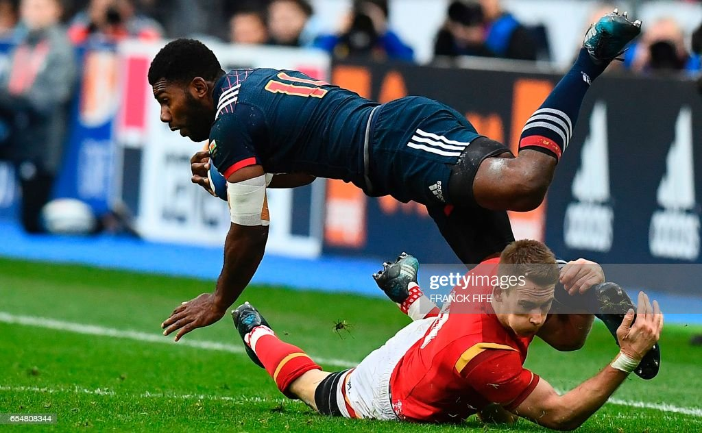 TOPSHOT - France's left wing Noa Nakaitaci (L) is tackled by Wales' left wing Liam Williams during the Six Nations international rugby union match between France and Wales at the Stade de France in Saint-Denis on March 18, 2017. /