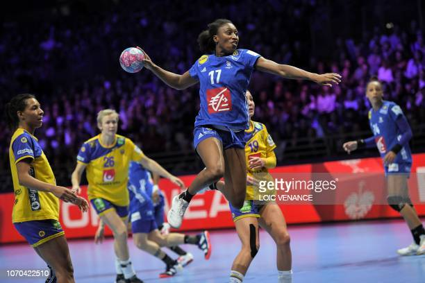 France's left wing Siraba Dembele Pavlovic jumps to shoot during the Women Euro 2018 handball Championships Group 1 main round match between Sweden...