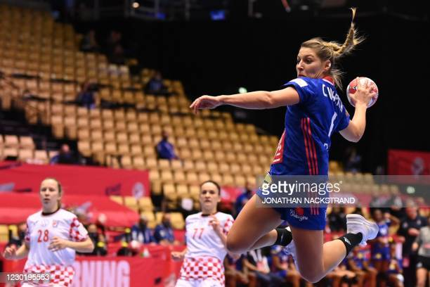 France's left winger Chloe Valentini jumps for a shot during the semi-final match between France and Croatia of the 2020 EHF European Women's...