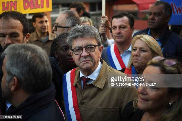 France's leftist party La France Insoumise president JeanLuc Melenchon looks on as he arrives at the courthouse in Bobigny on September 19 2019...