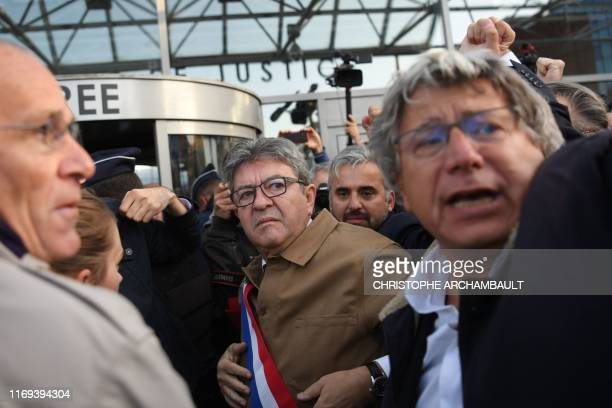 France's leftist party La France Insoumise president Jean-Luc Melenchon looks on as he arrives with LFI MPs Alexis Corbiere and Eric Coquerel at the...