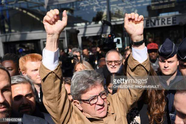 France's leftist party La France Insoumise President Jean-Luc Melenchon reacts after leaving the courthouse in Bobigny, north of the French capital...