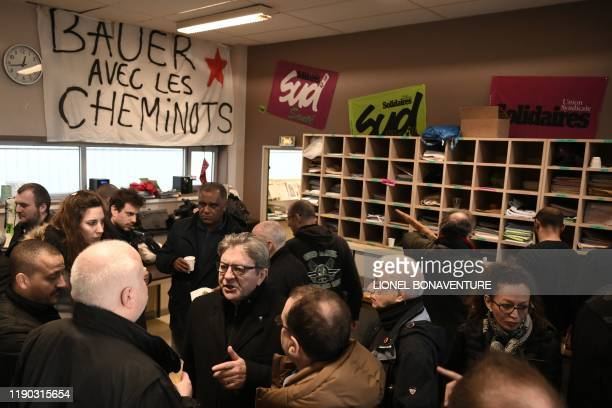 France's leftist party La France Insoumise president JeanLuc Melenchon speaks with rail workers on strike during a Christmas lunch at the unions...