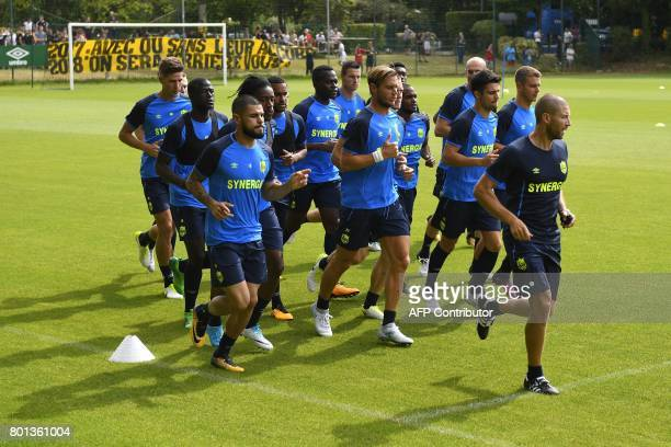 France's Ligue 1 football club FC Nantes' players warm up during a training session at the FC Nantes headquarters on June 26 2017 in La Chapelle sur...