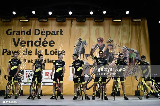 France's Lilian Calmejane and riders of France's Direct Energie cycling team pose on stage during the team presentation ceremony on July 5 2018 in La...