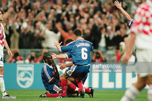 France's Lilian Thuram celebrates scoring his second goal in the semifinals match of the 1998 FIFA World Cup against Croatia | Location SaintDenis...