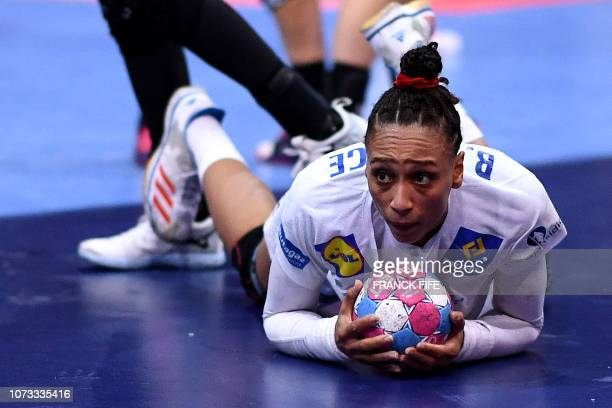 France's line player Beatrice Edwige lies on the floor during the EHF EURO 2018 European Women's Handball Championship semifinal match between...