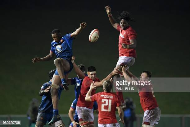 TOPSHOT France's lock Alban Roussel and Wales U20's Max Williams vie in the air for the ball during the Under20 Six Nations international rugby union...