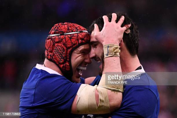 France's lock Bernard le Roux and France's flanker Charles Ollivon celebrate at the end of the Six Nations rugby union tournament match between...