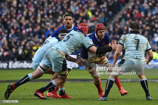France's lock Bernard Le Roux is tackled during the Six Nations international rugby union match between Scotland and France at Murrayfield Stadium in...
