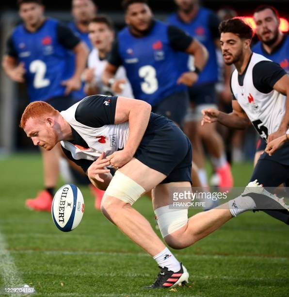 France's lock Kilian Geraci is tackled by France's scrum half Baptiste Serin during a training session on October 21 2020 in Marcoussis south of...
