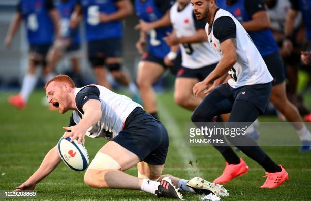 France's lock Kilian Geraci is tackled during a training session on October 21 2020 in Marcoussis south of Paris as part of the preparation of the...
