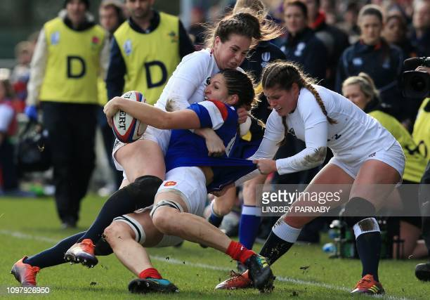 TOPSHOT France's lock Lenaig Corson is tackled during the Six Nations international women's rugby union match between England and France at Castle...