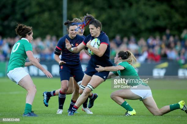France's lock Lenaig Corson is tackled during the Women's Rugby World Cup 2017 pool C rugby match between France and Ireland at The UCD Bowl in...