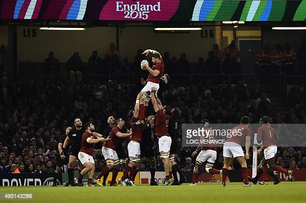 France's lock Pascal Pape and New Zealand's number 8 Kieran Read jump for the ball in a line out during a quarter final match of the 2015 Rugby World...