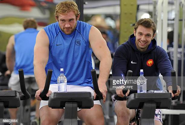 France's lock Romain MilloChluski and France's winger Vincent Clerc participate in an indoor training session on June 21 2009 in Wellington New...