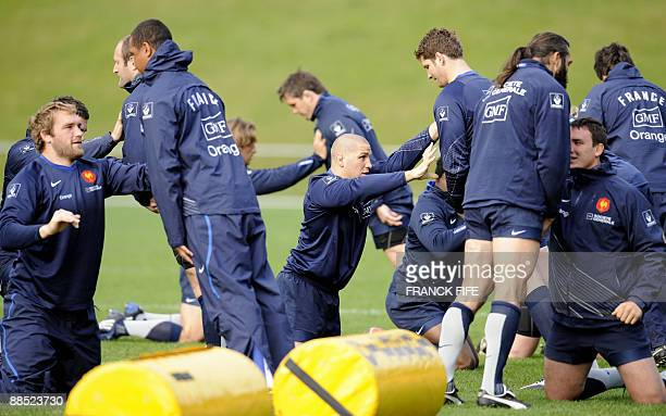 France's lock Romain MilloChluski flanker and captain Thierry Dusautoir prop Fabien Barcella lock Sebastien Chabal and n° 8 Louis Picamoles stretch...