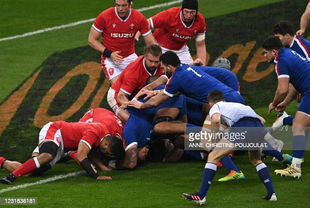 France's lock Romain Taofifenua scores a try during the Six Nations rugby union tournament match between France and Wales on March 20 at the Stade de...