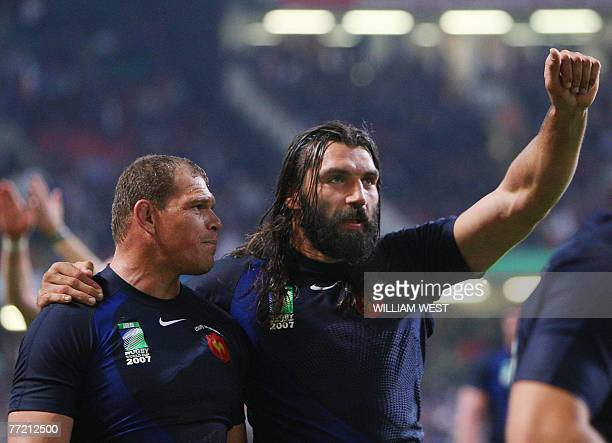 France's lock Sebastien Chabal and France's prop Pieter De Villiers celebrate at the end of the rugby union World Cup quarterfinal match New Zealand...