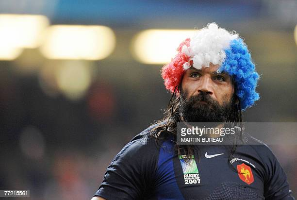 France's lock Sebastien Chabal celebrates at the end of the rugby union World Cup quarterfinal match New Zealand vs France 06 October 2007 at the...