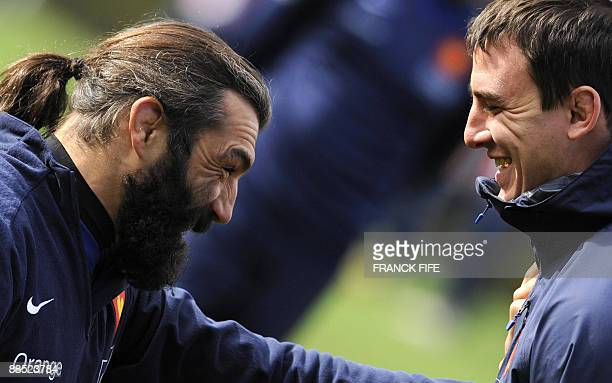 France's lock Sebastien Chabal jokes with n° 8 Louis Picamoles during a training session in Porirua on June 17 2009 France on June 17 made three...
