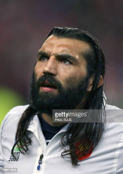 France's lock Sebastien Chabal listens to the national anthems prior the Rugby Union World Cup opening match France v. Argentina at the Stade de...