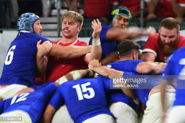 France's lock Sebastien Vahaamahina elbows Wales' flanker Aaron Wainwright during the Japan 2019 Rugby World Cup quarterfinal match between Wales and...