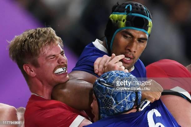 TOPSHOT France's lock Sebastien Vahaamahina elbows Wales' flanker Aaron Wainwright during the Japan 2019 Rugby World Cup quarterfinal match between...