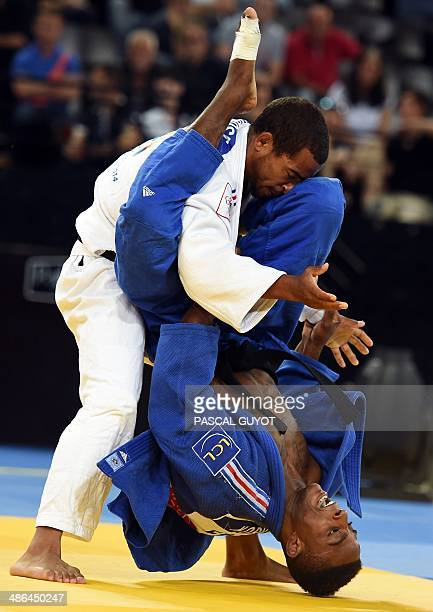 France's Loic Korval fights with France's Davis Larose during the 66kg category final of the Judo European Championships in Montpellier southwestern...