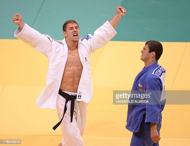 France's Loic Pietri celebrates after defeating Georgia's Avtandili Tchrikishvili during the 81kg category final of the IJF World Judo Championship...