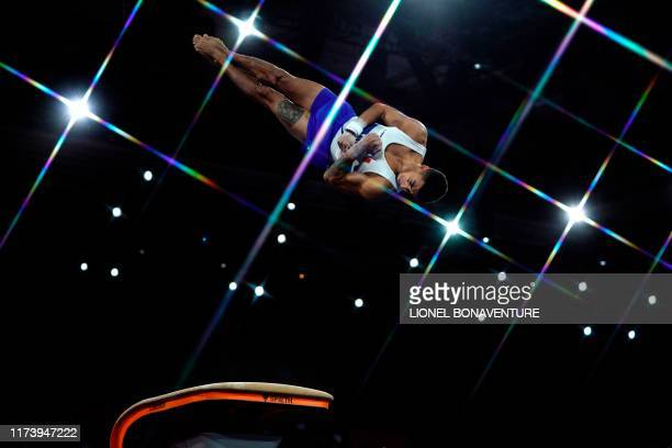 France's Loris Frasca performs during the men's qualifying session at the FIG Artistic Gymnastics World Championships at the HannsMartinSchleyerHalle...